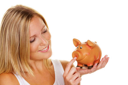 A young woman saves money and coins for the future. Pension and savings. photo