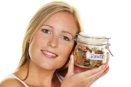provisions: A young woman saves money and coins for the future. Pension and savings.