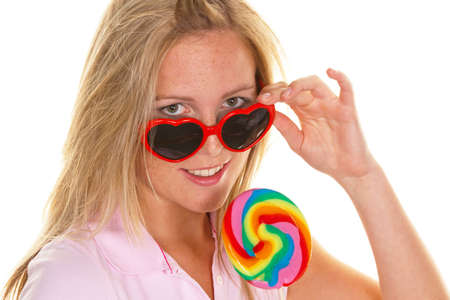 lolli: A young woman with a lollipop Schlecker says.