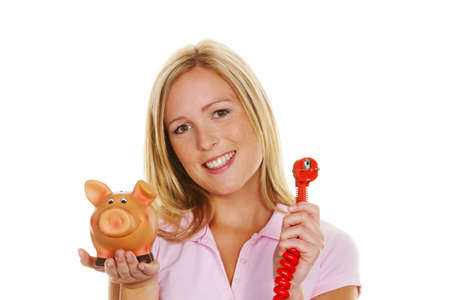 luminous flux: A young woman holding a piggy bank and a power plug. Symbolic photo for energy cost Stock Photo