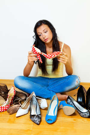 prostitution: A young woman has many different shoes to choose from