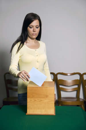 electoral system: A young woman with a voter in the voting booth. Voting in a democracy