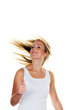 exempted: A young, successful woman holds his thumb up. Symbol for success, exempted white background Stock Photo
