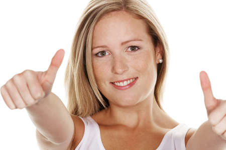 A young, successful woman holds his thumb up. Symbol for success, exempted white background Stock Photo - 10514225