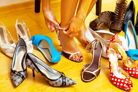 stilettos: A young woman has many different shoes to choose from