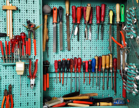 Cabinet with tool in a workshop. Equipment of a craft business Stock Photo - 10514248