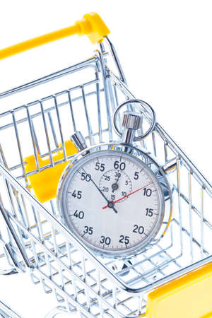 shop opening hours: A stopwatch is in a shopping cart icon image for opening times and working hours in retail.