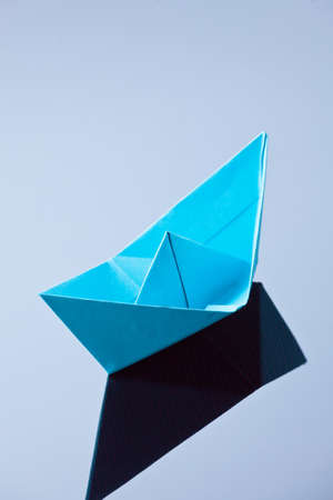 longing: A ship made of paper folded. Photo icon longing for arts and crafts.