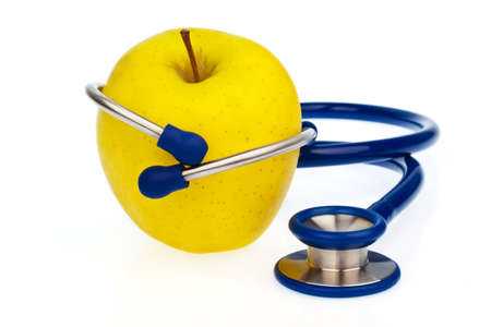 A stethoscope and an apple. Symbolic of a healthy diet. photo