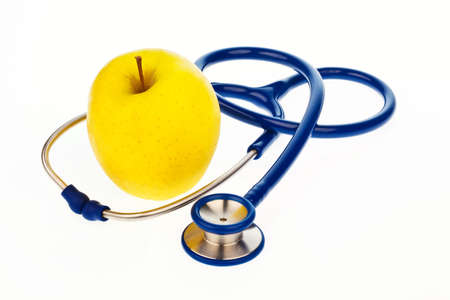 precaution: A stethoscope and an apple. Symbolic of a healthy diet.