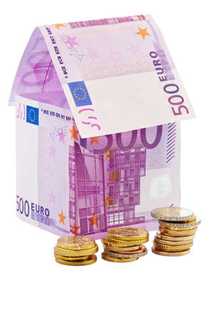 financed: A house built with money   on white background. Building society, building houses and buying a house. Stock Photo