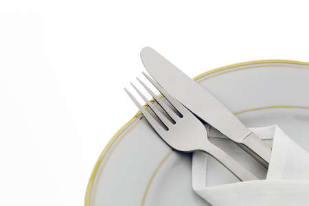 A knife with a fork and plate. Place setting for a dinner at the restaurant. photo