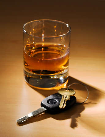 Car keys and a glass of alcohol on a table Stock Photo - 10537335