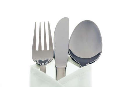 white napkin: A knife with a fork and plate. Place setting for a dinner at the restaurant.