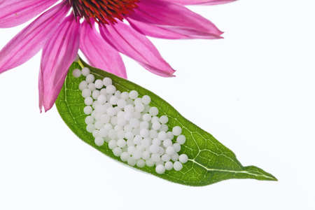 Globules in the treatment of diseases in the gentle, alternative medicine. Tablets and medicines. Stock Photo - 10537270