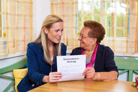 a grandchild visiting his grandmother, and read a contract between generations. Stock Photo - 10860748
