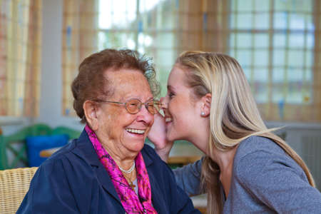 vivre: a grandchild visiting his grandmother. listen to the conversation. Stock Photo