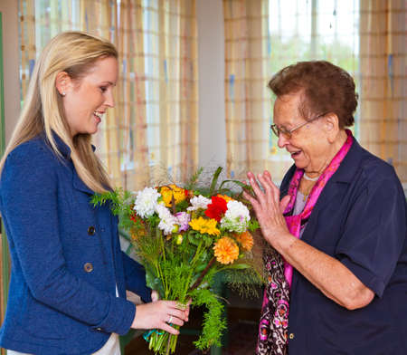 name day: a grandchild visiting his grandmother and bring flowers as a gift.