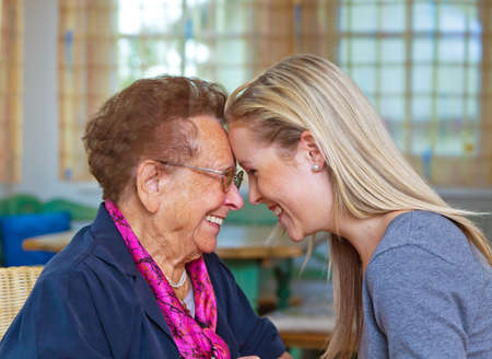 grandkids: a grandchild visiting his grandmother. listen to the conversation. Stock Photo