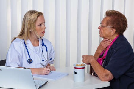 medizin: an elderly lady at the doctor in practice. consultation with the doctor.