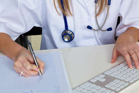 stethoskope: a young doctor in the doctors office. with stethoscope Stock Photo