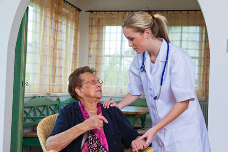 physican: the doctor comes to a sick old lady. home visits and house calls Stock Photo