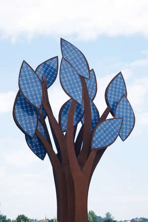 a tree with leaves of solar collectors. alternative energy photo