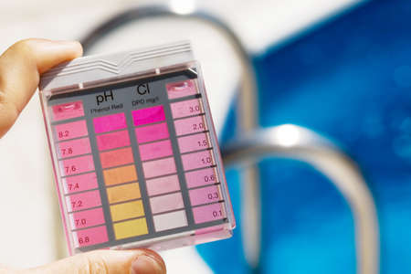 measured: the chlorine content and ph are measured. clean water in the pool Stock Photo