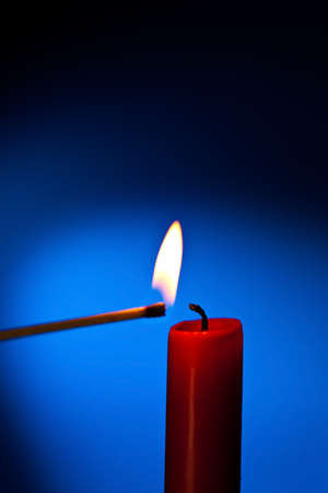 kindle: a red candle is lit with a match.