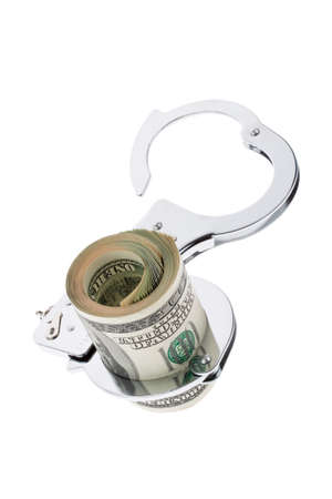 criminal act: many dollar bills with handcuffs on white background Stock Photo