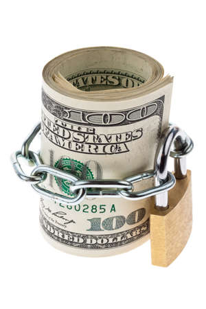 laundering: many dollar bills are locked with a lock