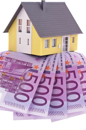 modell: many euro banknotes of the european union. buying a home. Stock Photo