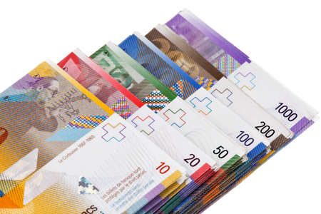 swiss francs lying on a white background photo