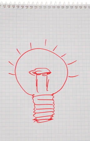bulb on drawing as a symbol of new ideas. photo
