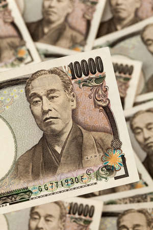 household money: many japanese yen bills. currency from japan
