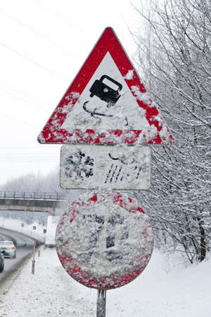 skidding: a snowy road signs skidding in winter Stock Photo