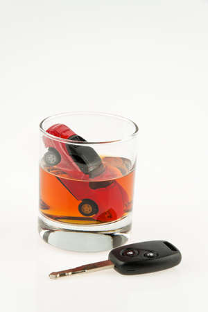 symbol for drunken driving. a car and a carkey in a glass Stock Photo - 11102853