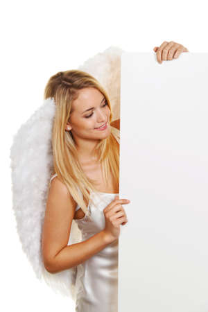 blonde angel at christmas with an empty board for requests and offers. Stock Photo - 11103840