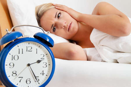 clock with sleep at night. woman can not sleep. Stock Photo - 11103859