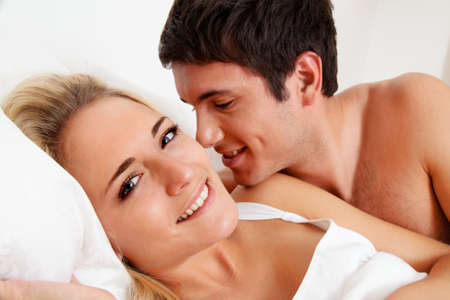 couple has fun in bed. laughter, joy and eroticism in the bedroom Stock Photo - 11103872