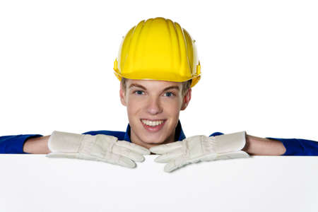 trainee: an apprentice  trainee as a craftsman with a blank panel