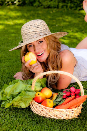 fruits and vegetables in the basket with his wife photo