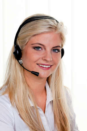 callcenter: young woman with telephone headset in a call center Stock Photo