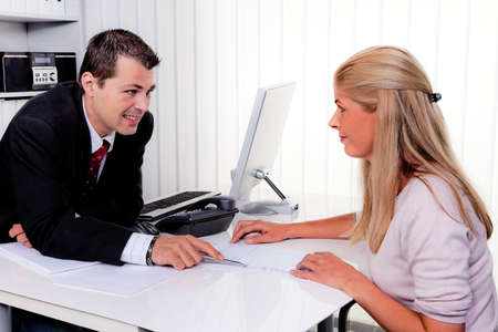 husband and wife in a counseling session in an office photo