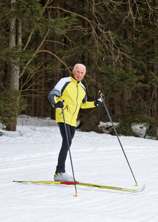 freetime: senior in winter on snow to cross country skiing with skis