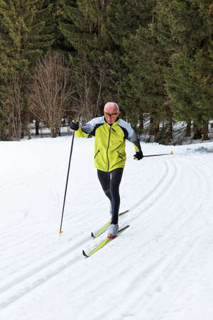 senior in winter on snow to cross country skiing with skis Stock Photo - 11103899