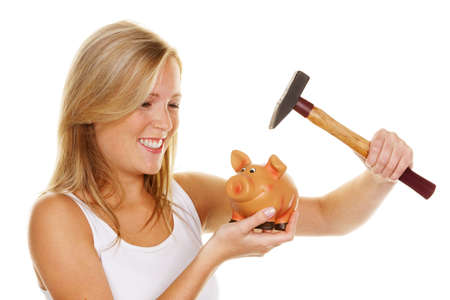 a young woman kills her piggybank with a hammer photo