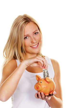 a young woman saves money and coins for the future. prevention and save with dollar bill photo