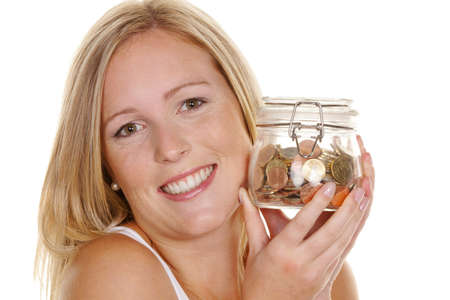 a young woman saves money and coins for the future. preparedness and save. Stock Photo - 11153993