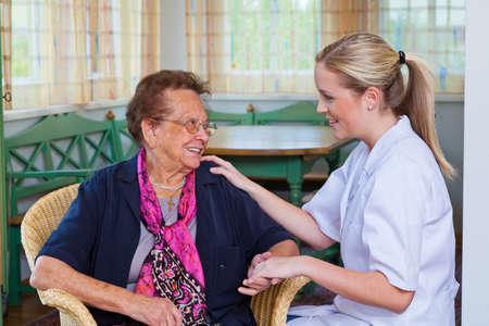 socially: a nurse home care visits a patient